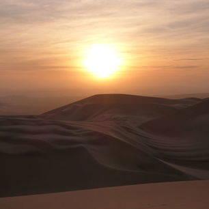 Zonsondergang-in-de-zandduinen-van-Huacachina