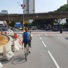 Gionne fietsen in Kuala Lumpur